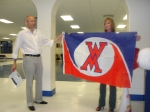 Robert Guillot is presented the new WHMS official flag in recognition of traveling the fartherest.  He came in all the w