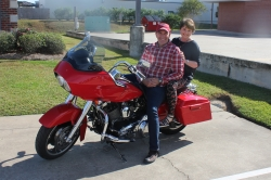 Chuck Adams and Cindy Little Cameron reinact their ride after 40 year reunion meeting.